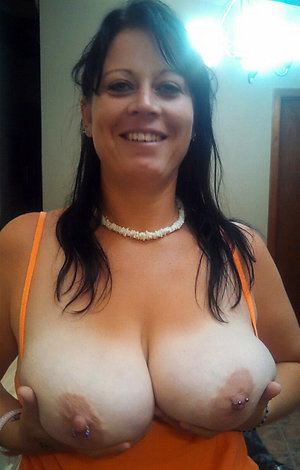 Amazing milf with big nipples pics