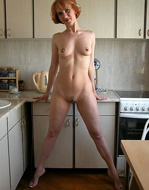 Magnificent naked mature redhead milf