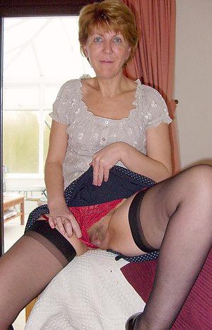 Beautiful redhead mature women posing nude