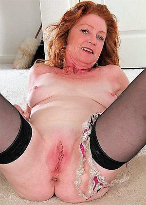 Amazing busty redhead mature milf