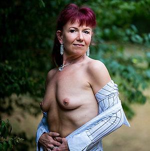 Busty amateur redhead milf sex pics