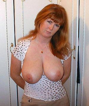 Stunning mature redhead nude stripped