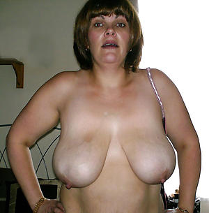 Pretty busty nude mature