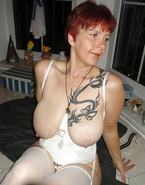Naughty tattoed mature women porn pics