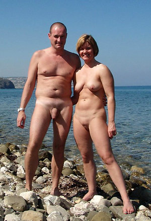 Amateur cute older couple poses for pictures