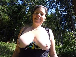Naughty torrid bosomy mature naked photos