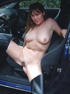 Beautiful grown up nude in car
