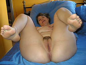 Old woman feet posing nude