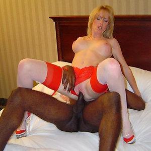 Naked  mature interracial fucking photos